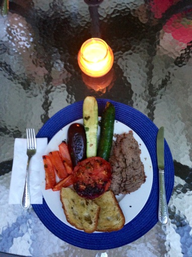 Finished flank steak, veggies, bread